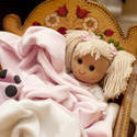 11955   Blond doll in a crib