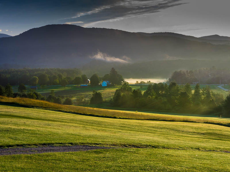 <p>Vermont morning valley and meadows with filtered light and fog.</p>