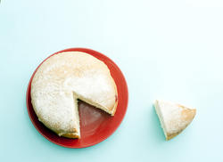 12348   Victoria sponge cake with a cut slice