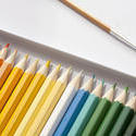 12202   Sharp colored pencils in box next to paintbrush