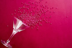 17298   Cocktail glass party background on red