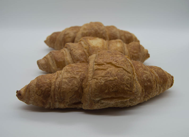 <p>Three croissants&nbsp;in a line with a white background</p>