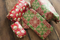 17281   Colourful wrapped Christmas gifts on rustic wood