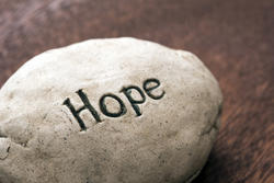 17411   The word Hope incised onto resin or stone