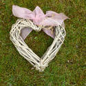 17363   Wicker heart with pink ribbon on the grass
