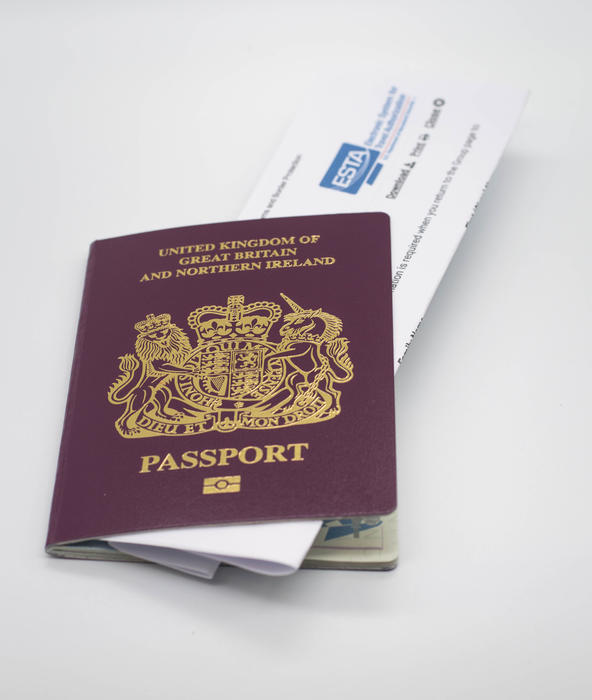 <p>A UK passport with an ESTA form on a white background</p>