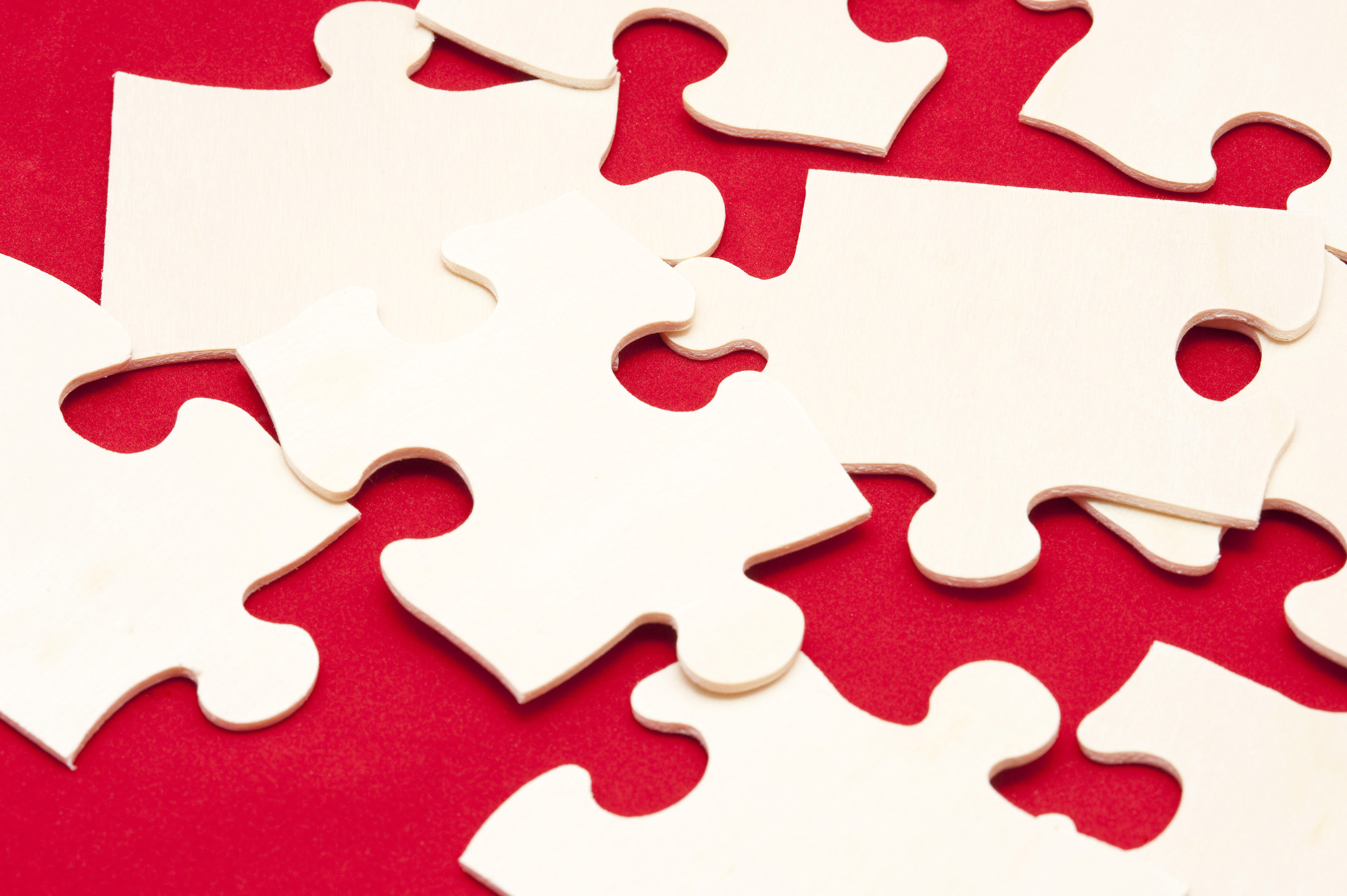 Free Stock Photo 10755 Scattered white jigsaw puzzle pieces | freeimageslive