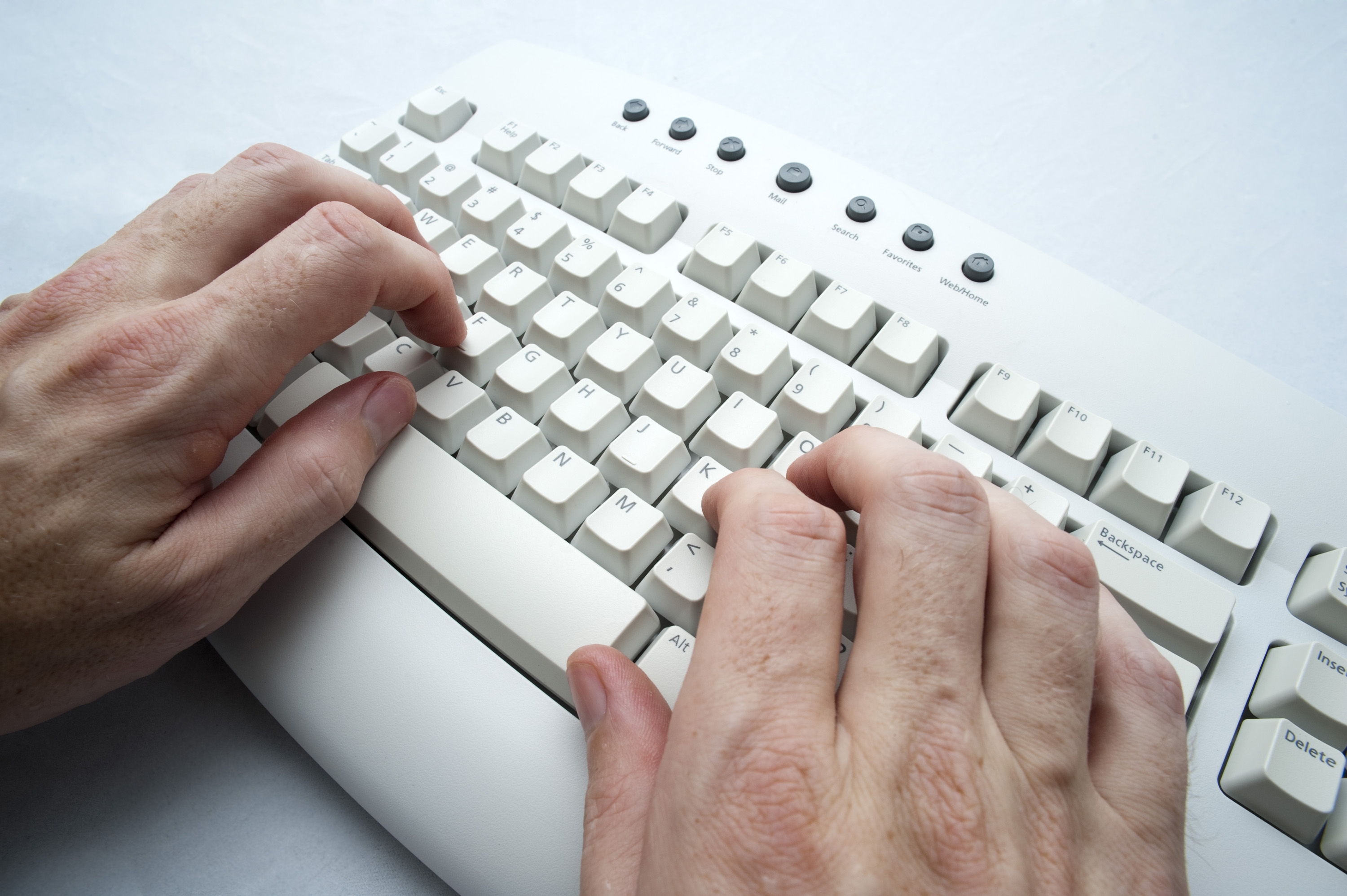 Free Stock Photo 3951-two hand typing | freeimageslive