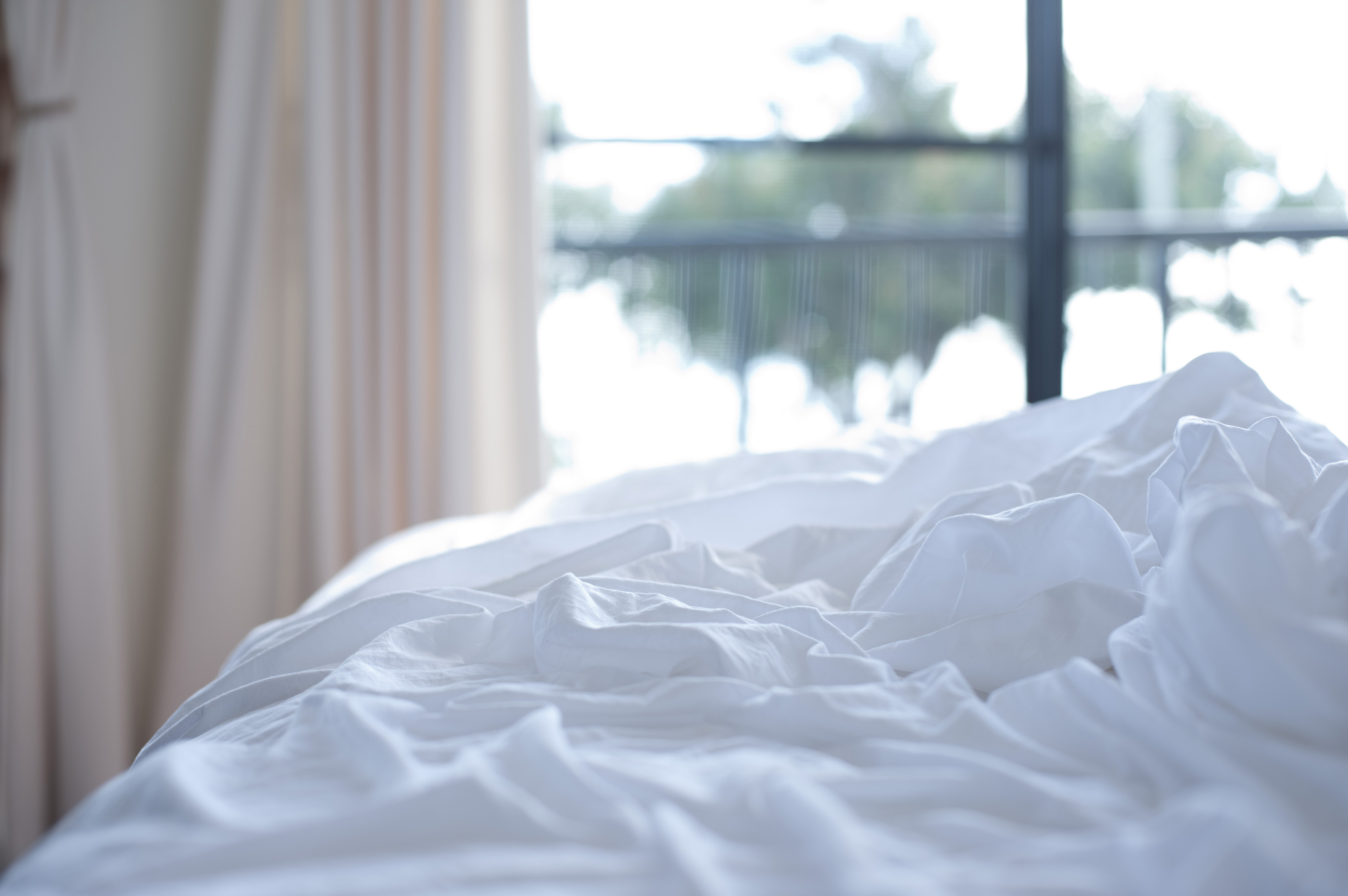 unmade bed side view. Unmade Bed With Messed Up White Linen In A Rumpled Heap And Daylight Streaming Side View D